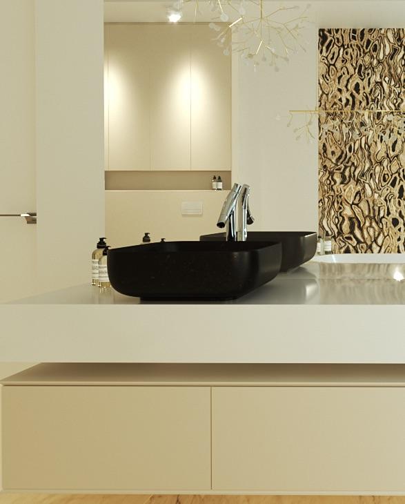 czarna umywalka w łazience ze złotymi elementami