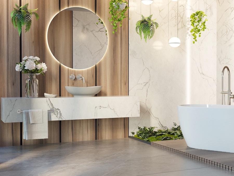 nowoczesna łązienka biofiliczna, umywalka z kamienia naturalnego, umywalka na cokole, szara kamienna umywalka, biała wanna wolnostojąca
