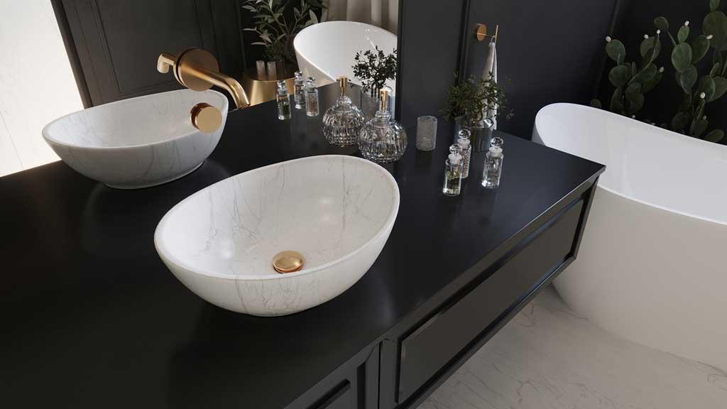 umywalka z białego marmuru, elegancka umywalka w eksluzywnej łązience, biało czarna łązienka, biała ergonomiczna wanna akrylowa, wanna do komfortowej kąpieli