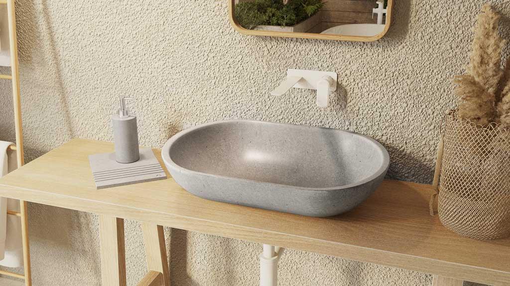 strefa umywalki z akcesoriami i marmurową umywalką, szare akcesoria łazienkowe z kamienia, kamienna umywalka nablatowa